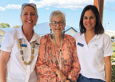 Village Manager, Mary O'Neill, Oak Tree Warwick Resident, Hilary Richardson with her dog Remi, National Sales & Marketing Manager, Jessica Lackner.